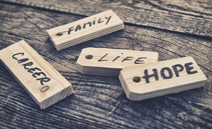 Wooden tiles reading Career, Family, Life, Hope